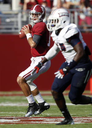 Photo -   Alabama quarterback AJ McCarron (10) looks to pass against Florida Atlantic during the first half of a NCAA college football game on Saturday, Sept. 22, 2012, in Tuscaloosa, Ala. (AP Photo/ Butch Dill)
