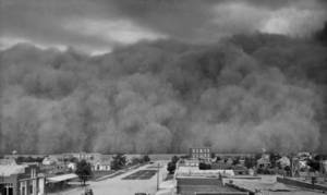 "photo - ""Like a towering tidal wave this cloud of Dust- Bowl-days dust hangs on the edge of Hooker, in Texas County, in this June 4, 1937, photograph."" Published in The Oklahoma City Times 2-25-77"
