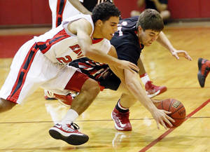 Photo - Del City's Brett Cannon (22) and Mustang's Geoff Hightower (35) chase a loose ball during a high school basketball between Del City and Mustang at Del City High School in Del City, Okla., Thursday, Dec. 27, 2012.  Photo by Nate Billings, The Oklahoman