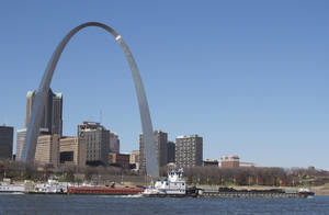 """Photo -   Two barges head north on the Mississippi River past St. Louis on Monday, Nov. 12, 2012, as seen from East St. Louis, Ill. Missouri Gov. Jay Nixon and the barge industry are pressing the federal government to take steps to keep enough water flowing on the drought-ridden Missouri and Mississippi rivers to avert a potential """"economic disaster,"""" given the Mississippi's importance as a commerce corridor. Winter typically is a low-water period on the two big rivers, but the situation is more dire this year with many points long the waterways at or near historic lows. (AP Photo/Jim Suhr)"""