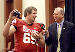 photo - OU / COLLEGE FOOTBALL: Oklahoma Sooners' Lane Johnson records himself as he interviewed by Brad Cesmat during a University of Oklahoma media day for the Insight Bowl at the Camelback Inn in Paradise Valley, Ariz.,  Wednesday, Dec. 28, 2011. Photo by Sarah Phipps, The Oklahoman
