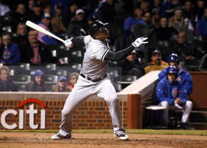 Photo - Chicago White Sox's Moises Sierra gets his fourth hit of the game off a pitch from Chicago Cubs relief pitcher Pedro Strop during the ninth inning of an interleague baseball game Tuesday, May 6, 2014, in Chicago. (AP Photo/Charles Rex Arbogast)