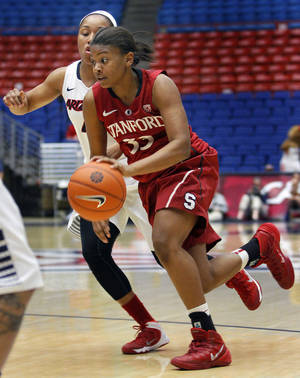 Photo - Stanford's Amber Orrange (33) dribbles past the defense of Arizona's Carissa Crutchfield in the first half of an NCAA college basketball game on Friday, Jan. 17, 2014, in Tucson, Ariz. (AP Photo/John Miller)