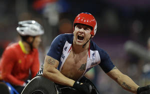Photo -   Britain's David Weir celebrates after winning the men's 800m T54 final at the 2012 Paralympics, Thursday, Sept. 6, 2012, in London. (AP Photo/Lefteris Pitarakis)