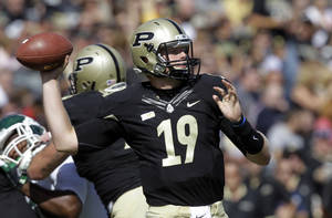 Photo -   Purdue quarterback Caleb TerBush throws against Eastern Michigan during the first half of an NCAA college football game in West Lafayette, Ind., Saturday, Sept. 15, 2012. (AP Photo/Michael Conroy)