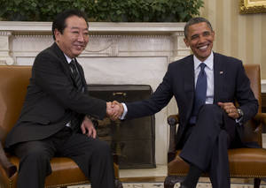 Photo -   President Barack Obama meets with Japanese Prime Minister Yoshihiko Noda in the Oval Office of the White House in Washington, Monday, April 30, 2012. (AP Photo/Pablo Martinez Monsivais)
