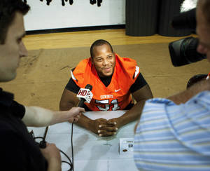 Photo - Oklahoma State offensive lineman Brandon Webb talks to reporters at the Oklahoma State football media day held at Gallagher-Iba Arena in Stillwater on August 3, 2013. KT King, For The Oklahoman
