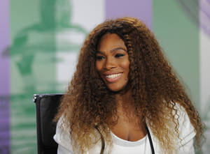 Photo - In this photo taken on Sunday, June 23, 2013 and made available by The All England Lawn Tennis & Croquet Club Wimbledon, defending women's champion Serena Williams of the United States speaks to the media during a press conference at Wimbledon. The Championships start Monday, with Serena Williams attempting to win the title for the sixth time. (AP Photo/Jon Buckle/AELTC)