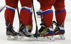 Photo - Russia forward Alexander Radulov, left, forward Ilya Kovalchuk, center and forward Alexander Ovechkin huddle during a training session at the 2014 Winter Olympics, Monday, Feb. 10, 2014, in Sochi, Russia. (AP Photo/Julie Jacobson)