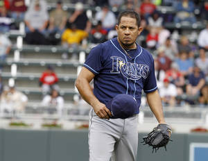 Photo - Tampa Bay Rays relief pitcher Joel Peralta reacts after a home run by Minnesota Twins' Ryan Doumit during the eighth inning of a baseball game in Minneapolis, Sunday, Sept. 15, 2013. The Twins won 6-4. (AP Photo/Ann Heisenfelt)