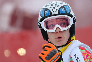 Photo - Germany's Maria Hoefl-Riesch stands on the alpine skiing training slopes at the Sochi 2014 Winter Olympics, Monday, Feb. 17, 2014, in Krasnaya Polyana, Russia. (AP Photo/Alessandro Trovati)