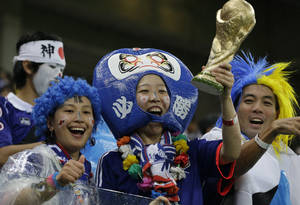 Photo - Japanese supporters react before the start of  the group C World Cup soccer match between Ivory Coast and Japan at the Arena Pernambuco in Recife, Brazil, Saturday, June 14, 2014. (AP Photo/Shuji Kajiyama)