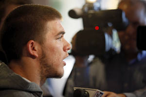 photo - COLLEGE FOOTBALL: J.W. Walsh speaks to the media during the OSU spring football press conference at Boone Pickens Stadium on the campus of Oklahoma State University in Stillwater, Okla., Monday, March 12, 2012. Photo by Nate Billings, The Oklahoman