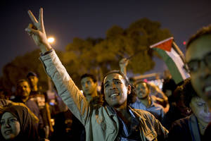 photo -   Egyptians chant slogans against latest Israel airstrikes in Gaza during a protest in Cairo, Wednesday, Nov. 14, 2012. Egypt has recalled its ambassador to Israel after an Israeli airstrike killed the military commander of Gaza's ruling Hamas. In a statement read on state TV, a spokesman says that President Mohammed Morsi recalled the ambassador and has asked the Arab League's secretary general to convene an emergency ministerial meeting in the wake of the Gaza violence. (AP Photo/Bernat Armangue)