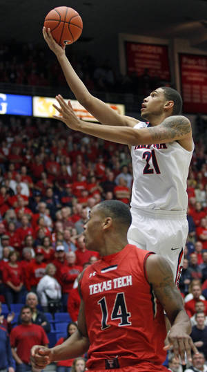 Photo - Arizona's Brandon Ashley (21) goes up for a shot as Texas Tech's Robert Turner (14) watches in the first half of an NCAA college basketball game on Tuesday, Dec. 3, 2013, in Tucson, Ariz. (AP Photo/John MIller)