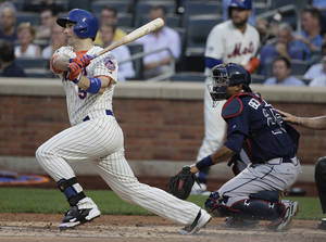 Photo - New York Mets' David Wright (5) follows through on a base hit to drive in Daniel Murphy for a run against the Atlanta Braves in the second inning of a baseball game, Tuesday, July 8, 2014, in New York. (AP Photo/Julie Jacobson)