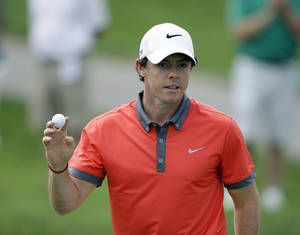 Photo - Rory McIlroy, of Northern Ireland, reacts following a birdie on the 13th hole during the first round of the Memorial golf tournament Thursday, May 29, 2014, in Dublin, Ohio. (AP Photo/Darron Cummings)