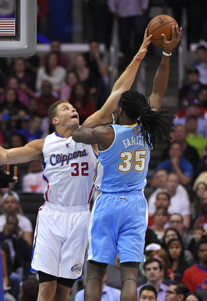 Photo - Denver Nuggets forward Kenneth Faried, right, shoots as Los Angeles Clippers forward Blake Griffin defends during the first half of an NBA basketball game, Tuesday, April 15, 2014, in Los Angeles.  (AP Photo/Mark J. Terrill)