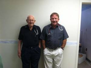 Photo - Dr. J.L. Wheeler, 90, poses with his son, Dr. Paul E. Wheeler, 51, in their Boise City, Okla., medical clinic Friday, June 17, 2011. <strong> - Provided</strong>