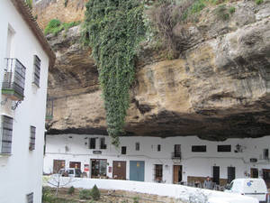 "Photo - This Jan. 17, 2013 photo shows the narrow road of Setenil de las Bodegas. Many of the houses and stores in this Spanish ""pueblo blanco,"" or white village, are carved into river-eroded rock. (AP Photo/Giovanna Dell'Orto)"