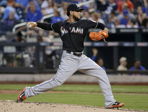 Photo - Miami Marlins pitcher Henderson Alvarez delivers against the New York Mets in the fourth inning of a baseball game, Friday, July 11, 2014, in New York. (AP Photo/Julie Jacobson)