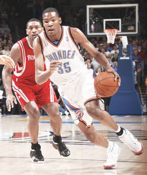 Photo - The Thunder's Kevin Durant, right, has averaged 24.7 points per game under Scott Brooks.  PHOTO BY NATE BILLINGS, THE OKLAHOMAN