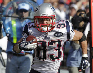 Photo - New England Patriots' Wes Welker (83) signed his franchise tender Tuesday with the Patriots. (AP Photo/David Duprey, File) ORG XMIT: NY151