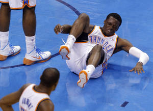 Photo -                    Thunder guard Reggie Jackson injured his ankle during Game 4, but returned to the court.                                        Photo by Bryan Terry, The Oklahoman