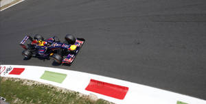 Photo - Red Bull driver Sebastian Vettel of Germany steers his car during the second free practice at the Monza racetrack, in Monza, Italy , Friday, Sept. 6 , 2013. The Formula one race will be held on Sunday. (AP Photo/Alessandro Trovati)