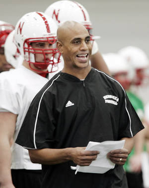 Photo -   FILE - In this March 26, 2008, file photo, Nebraska assistant coach Ron Brown calls a play during the first day of spring NCAA college football practice in Lincoln, Neb. The 55-year-old Brown knows he walks a fine line as a high-profile employee of a taxpayer-funded university. His detractors say he crossed it last month when he attended an Omaha City Council hearing and testified against an anti-discrimination ordinance that extended protections to gay and transgender people. (AP Photo/Nati Harnik, File)