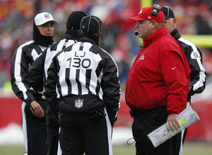Photo - Kansas City Chiefs coach Andy Reid, right, talks with officials during the first half of an NFL football game against the Indianapolis Colts at Arrowhead Stadium in Kansas City, Mo., Sunday, Dec. 22, 2013. (AP Photo/Ed Zurga)