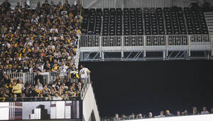 Photo - A section of empty seats are seen at Cowboys Stadium before the NFL football Super Bowl XLV  game between the Green Bay Packers and the Pittsburgh Steelers Sunday, Feb. 6, 2011, in Arlington, Texas. The seats were deemed unsafe. (AP Photo/Chris O'Meara)