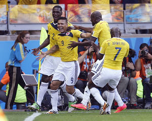 Photo - Colombia's Teofilo Gutierrez, centre, celebrates after scoring his side's second goal during the group C World Cup soccer match between Colombia and Greece at the Mineirao Stadium in Belo Horizonte, Brazil, Saturday, June 14, 2014.  (AP Photo/Frank Augstein)