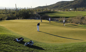 photo - Webb Simpson putts on the 18th green in the quarterfinal round of play against Hunter Mahan during the Match Play Championship golf tournament, Saturday, Feb. 23, 2013, in Marana, Ariz. Mahan won 1-up. (AP Photo/Ross D. Franklin)