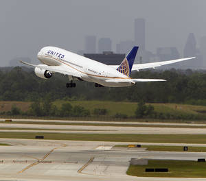 Photo - United's flight UAL 1 Boeing 787 Dreamliner takes off from Bush Intercontinental Airport on the 787's first North American flight since being grounded for several months because of problems with its batteries Monday, May 20, 2013, in Houston. The United flight will be from Houston's Bush Intercontinental to Chicago O'Hare. (AP Photo/Houston Chronicle, James Nielsen )