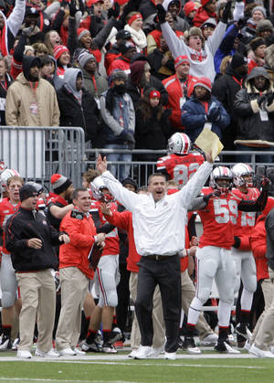 Photo -   Ohio State head coach Urban Meyer celebrates as time runs off the clock in their 26-21 win over Michigan in an NCAA college football game Saturday, Nov. 24, 2012, in Columbus, Ohio. (AP Photo/Jay LaPrete)