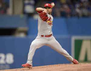 Photo - St .Louis Cardinals starter Jamie Garcia pitches to the Toronto Blue Jays during a baseball game in Toronto, Sunday, June 8, 2014. (AP Photo/The Canadian Press, Frank Gunn)