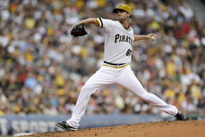 Photo - Pittsburgh Pirates starting pitcher Kris Johnson (60) delivers during the second inning of a baseball game against the St. Louis Cardinals in Pittsburgh Sunday, Sept. 1, 2013. (AP Photo/Gene Puskar)