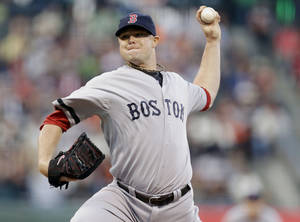 Photo - Boston Red Sox starting pitcher Jon Lester throws to the San Francisco Giants during the first inning of a baseball game on Monday, Aug. 19, 2013, in San Francisco. (AP Photo/Marcio Jose Sanchez)