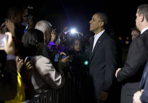Photo - President Barack Obama greets supporters after arriving at West Palm Beach International Airport on Friday, Feb. 15, 2013, in West Palm Beach, Fla. President Obama is spending the weekend in Palm City, Fla.  (AP Photo/Evan Vucci)