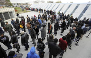 Photo -   Voters wait in line to receive absentee ballots at the Wayne County Community College Northwest Campus in Detroit, Monday, Nov. 5, 2012. Voters flocked to local clerks offices Monday for the final day of absentee balloting with a three-to-five-hour wait in Detroit as thousands flocked to cast ballots. (AP Photo/Detroit News, David Guralnick)