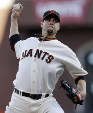 Photo -   San Francisco Giants starting pitcher Ryan Vogelsong throws during the first inning of Game 6 of baseball's National League championship series against the St. Louis Cardinals Sunday, Oct. 21, 2012, in San Francisco. (AP Photo/Ben Margot)