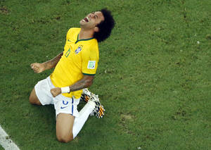 Photo - Brazil's Marcelo celebrates after the World Cup quarterfinal soccer match between Brazil and Colombia at the Arena Castelao in Fortaleza, Brazil, Friday, July 4, 2014. Brazil won 2-1. (AP Photo/Fabrizio Bensch, pool)