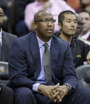 Photo - Cleveland Cavaliers head coach Mike Brown watches from the bench in the second half of an NBA basketball game against the Brooklyn Nets, Wednesday, April 16, 2014, in Cleveland. The Cavaliers defeated the Nets 114-85. (AP Photo/Tony Dejak)