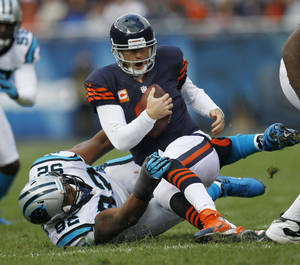 Photo -   Chicago Bears quarterback Jay Cutler (6) is tackled by Carolina Panthers defensive tackle Dwan Edwards (92) during the first half of an NFL football game in Chicago, Sunday, Oct. 28, 2012. (AP Photo/Charles Rex Arbogast)