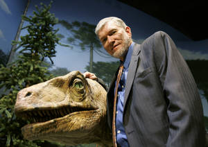 "Photo - FILE - In this May 24, 2007 file photo, Ken Ham, founder of the nonprofit ministry Answers in Genesis, poses with one of his favorite animatronic dinosaurs during a tour of the Creation Museum in Petersburg, Ky. Ham, who recently debated evolution with TV's ""Science Guy"" Bill Nye, says fundraising after the widely watched event helped to revive stalled plans to build a 510-foot replica of Noah's Ark. (AP Photo/Ed Reinke, File)"