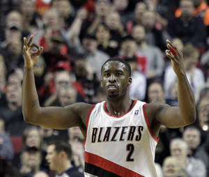 Photo - Portland Trail Blazers guard Wesley Matthews signals after sinking a three point shot during the first half of an NBA basketball game against the Oklahoma City Thunder in Portland, Ore., Wednesday, Dec. 4, 2013. (AP Photo/Don Ryan)