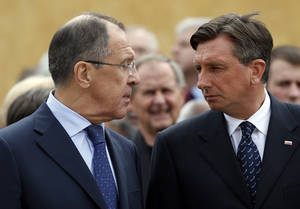 Photo - Russia's foreign minister Sergey Lavrov, left, and Slovenia's President Borut Pahor look at each other in Maribor, Slovenia, Tuesday, July 8, 2014, during the opening ceremony for a museum commemorating WWII camp for captured Soviet prisoners of war. (AP Photo/Darko Bandic)