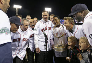 "Photo -   Members of the 2004 World Series Championship Boston Red Sox yell ""play ball"" as they are honored during ceremonies at Fenway Park before a baseball game against the Tampa Bay Rays in Boston, Tuesday, Sept. 25, 2012. (AP Photo/Elise Amendola)"