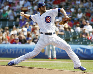 Photo - Chicago Cubs starting pitcher Jake Arrieta pitches against the Philadelphia Phillies during the first inning of a baseball game on Sunday, Sept. 1, 2013, in Chicago. (AP Photo/Andrew A. Nelles)